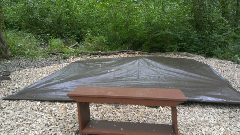 The sand stays clean and dry under a tarp!